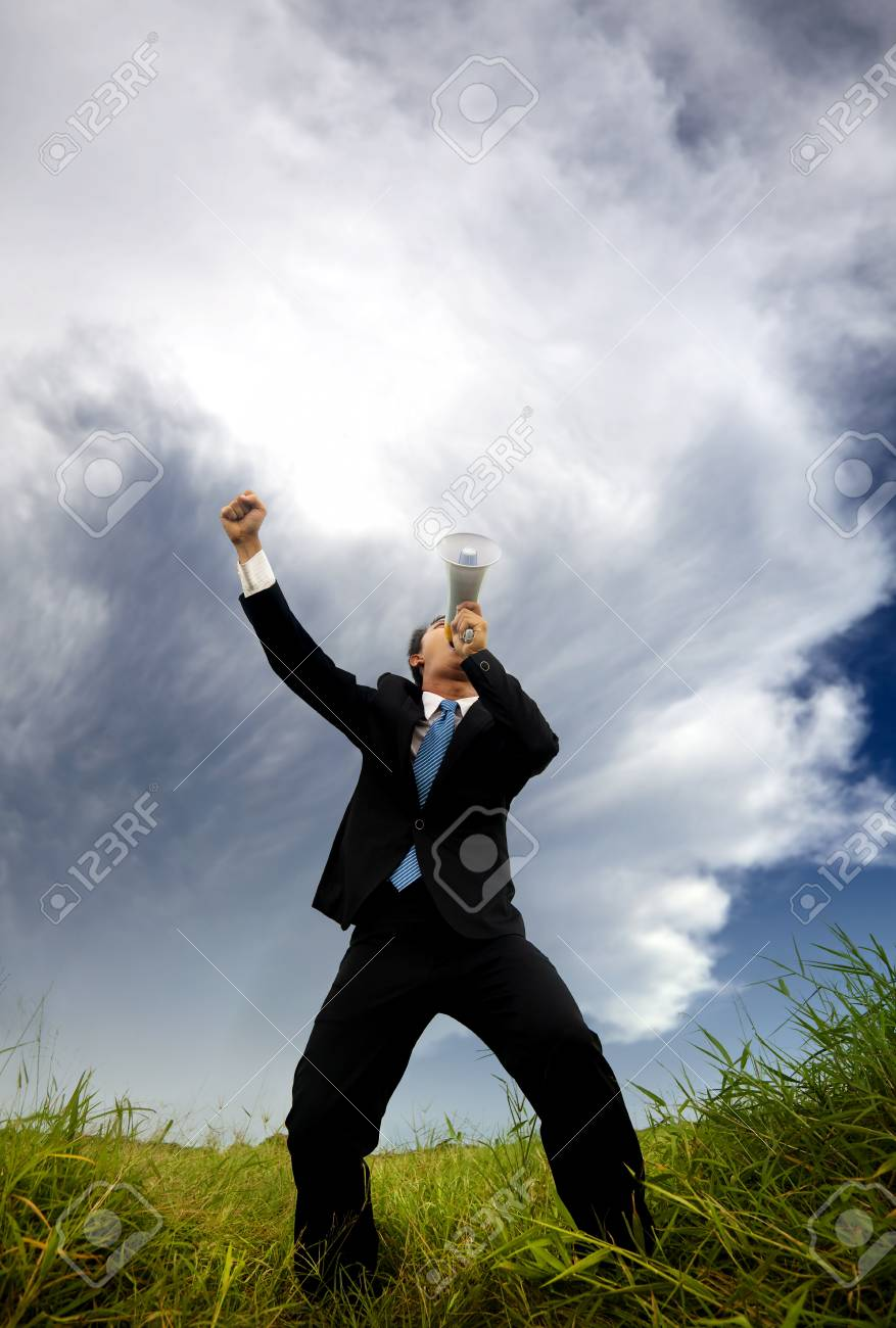 man in the black suit and holding megaphone shouting to the storm Stock Photo - 12016839