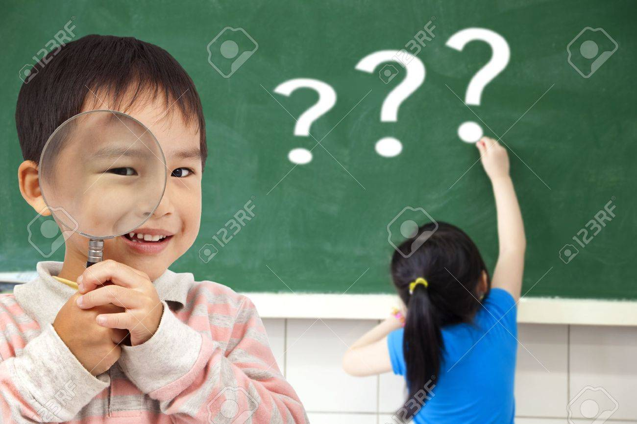 happy kids with drawing question mark in the classroom Stock Photo - 12613592