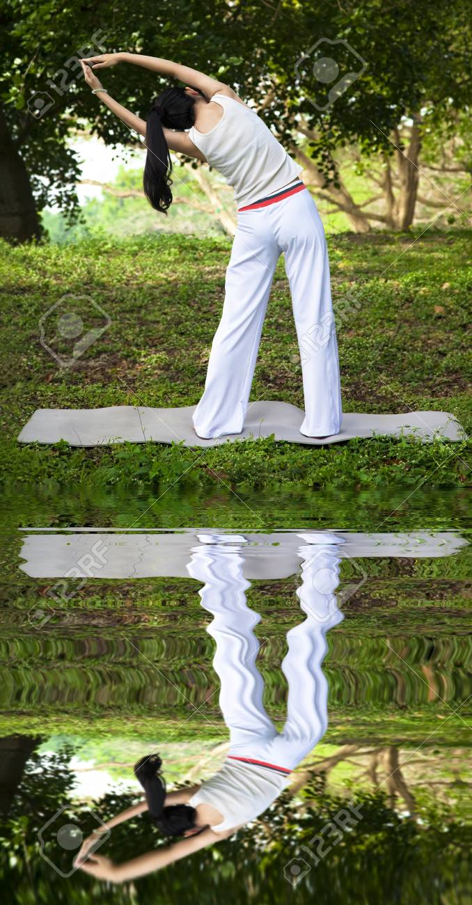 yoga girl with water reflecting Stock Photo - 12870297