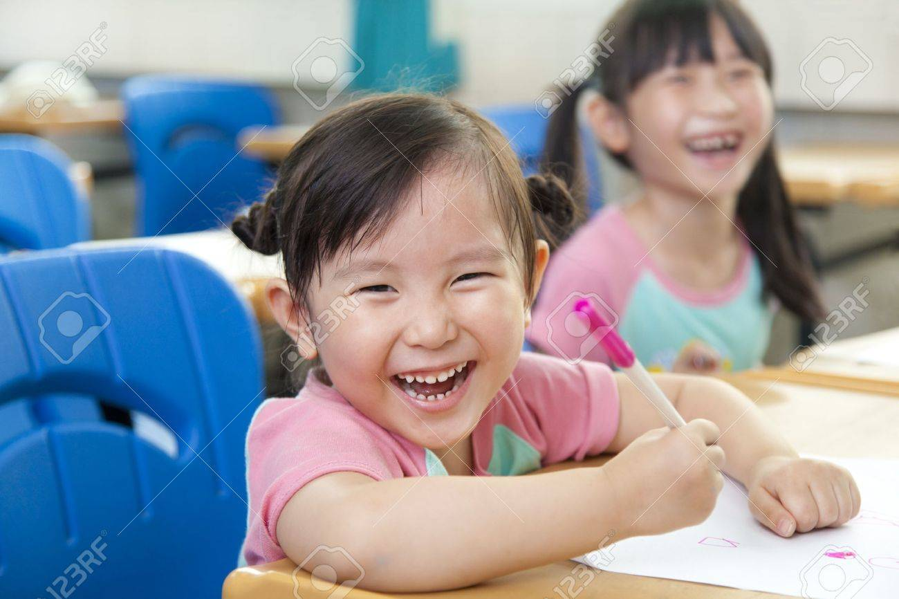 happy little girls in the classroom Stock Photo - 13550130