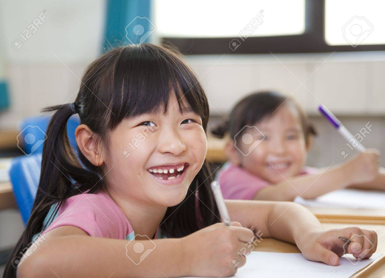happy children in the classroom Stock Photo - 13550020