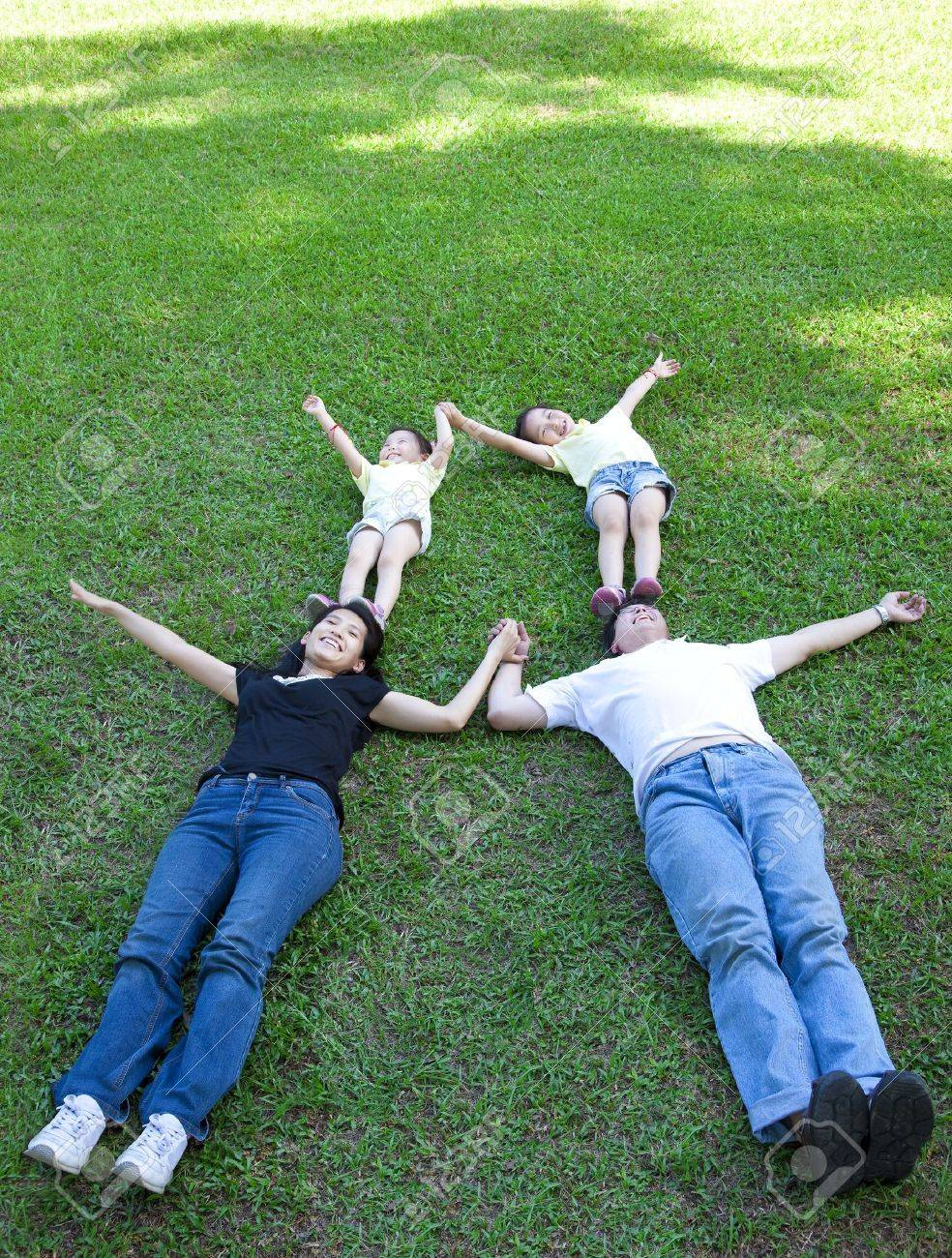 asian family lying on the grass Stock Photo - 13977968