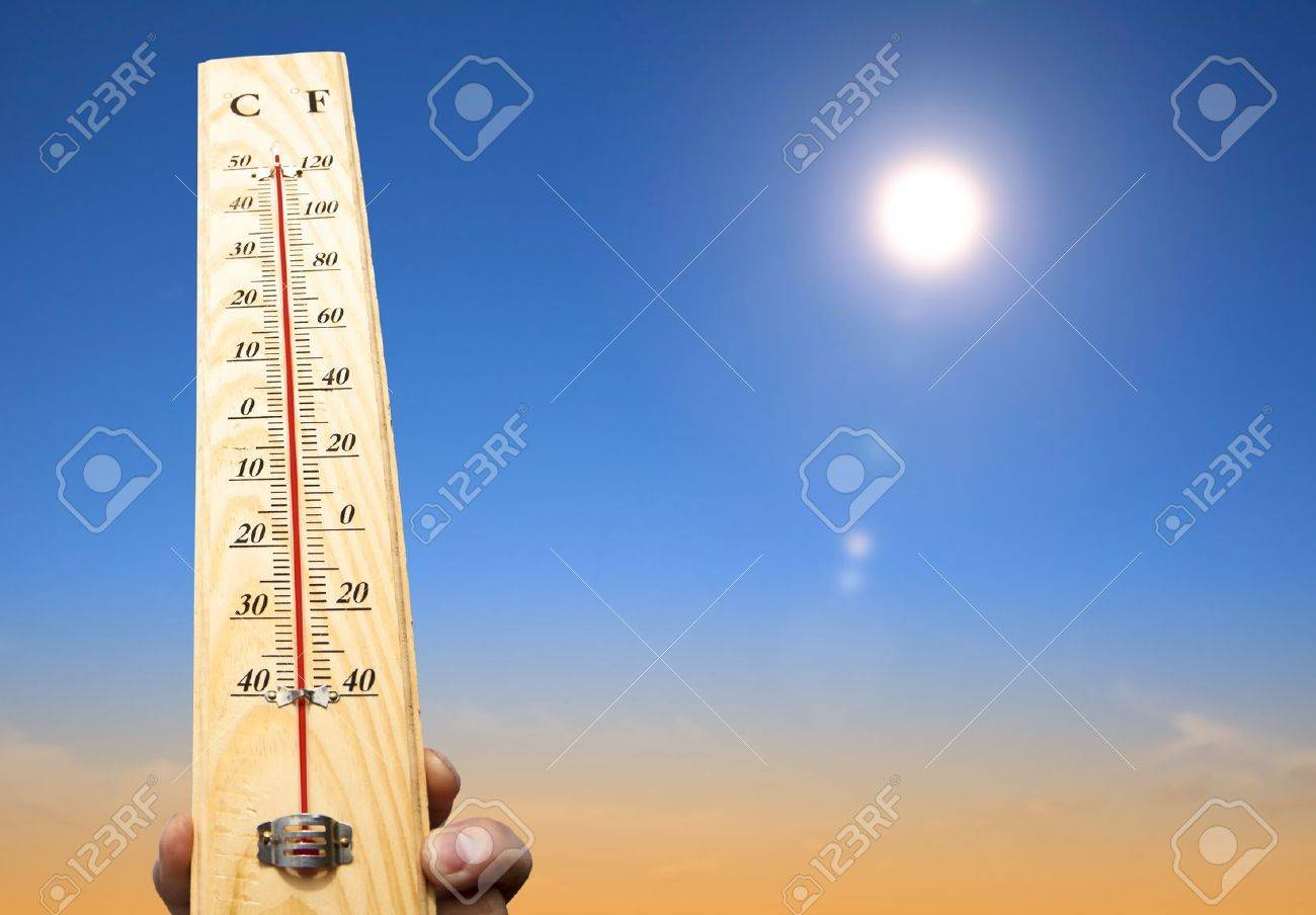 hand holding thermometer and heat weather Stock Photo - 14394425