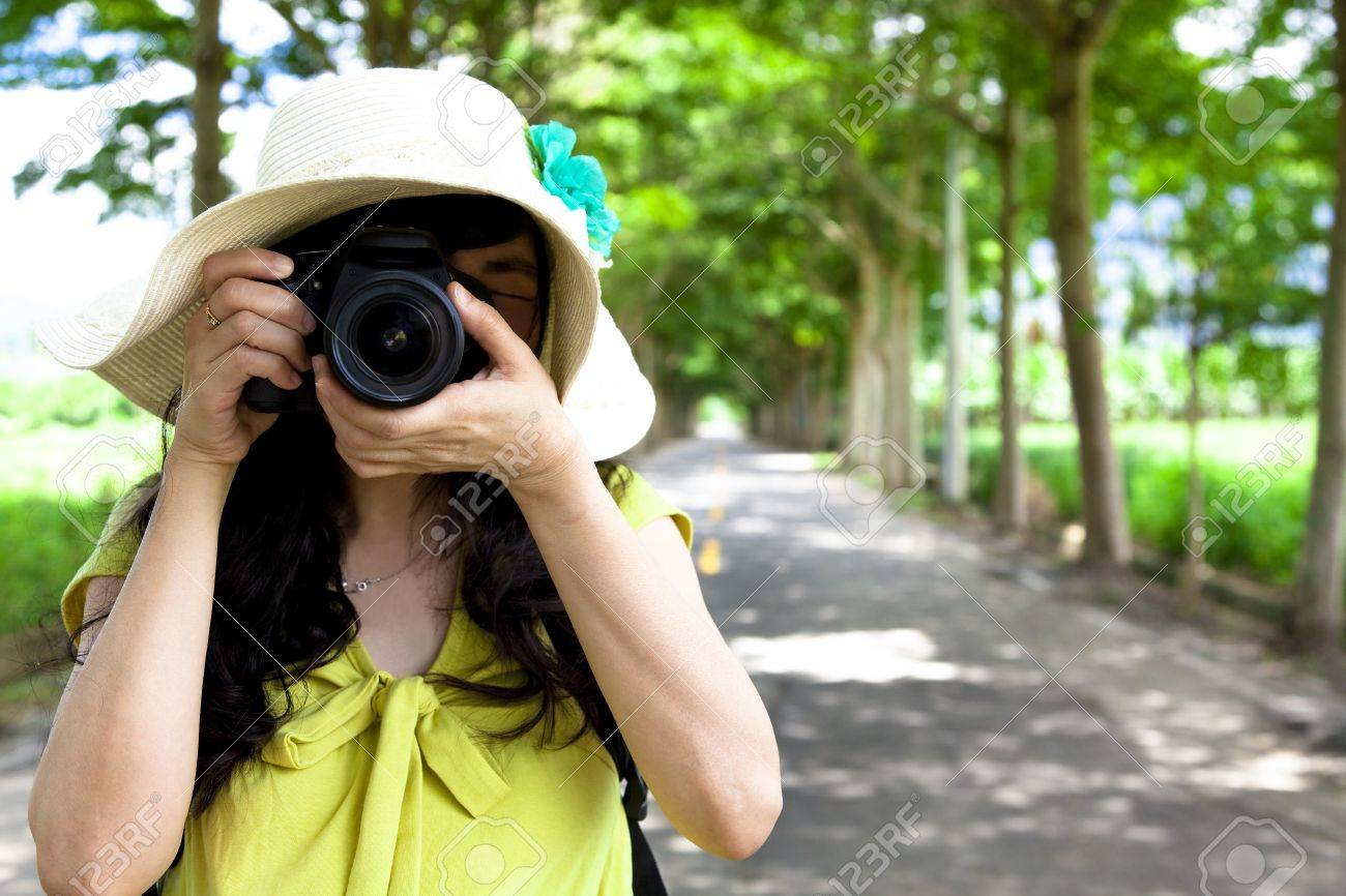 Young traveler taking photo in the green forest Stock Photo - 14429662
