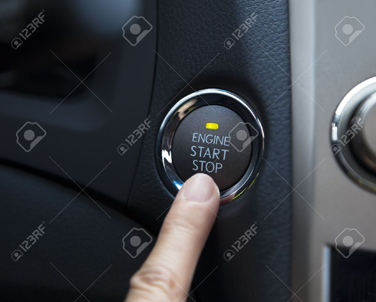 finger pressing the Engine start stop button of a car Stock Photo - 15729140