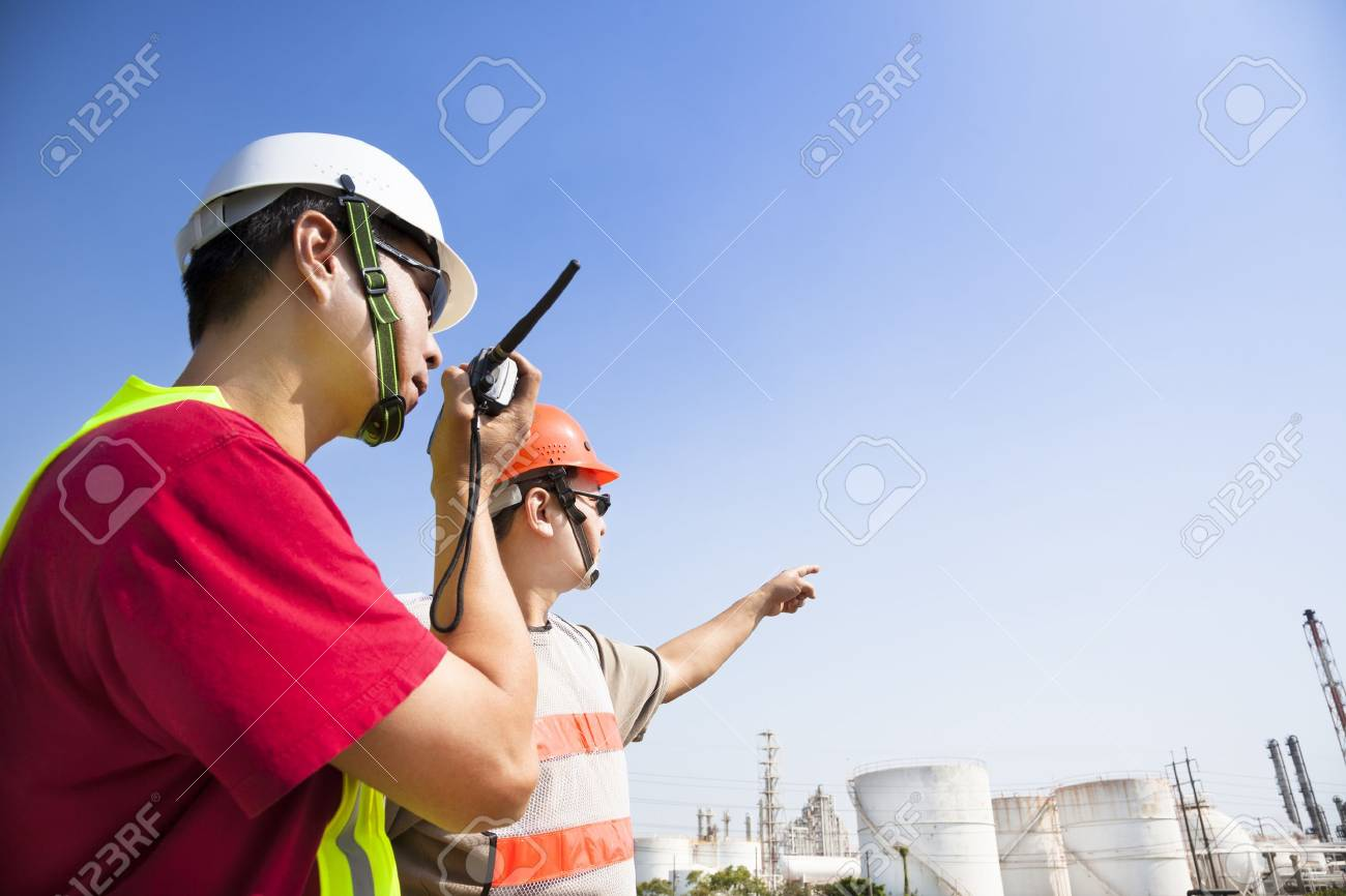 two refinery workers looking the large refinery background Stock Photo - 16276300