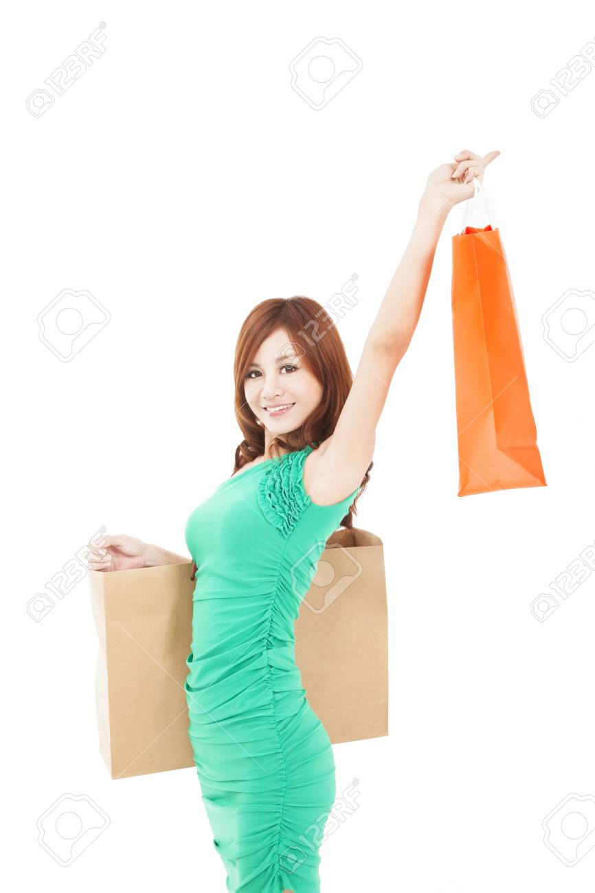 happy young asian woman holding shopping bag Stock Photo - 17850448