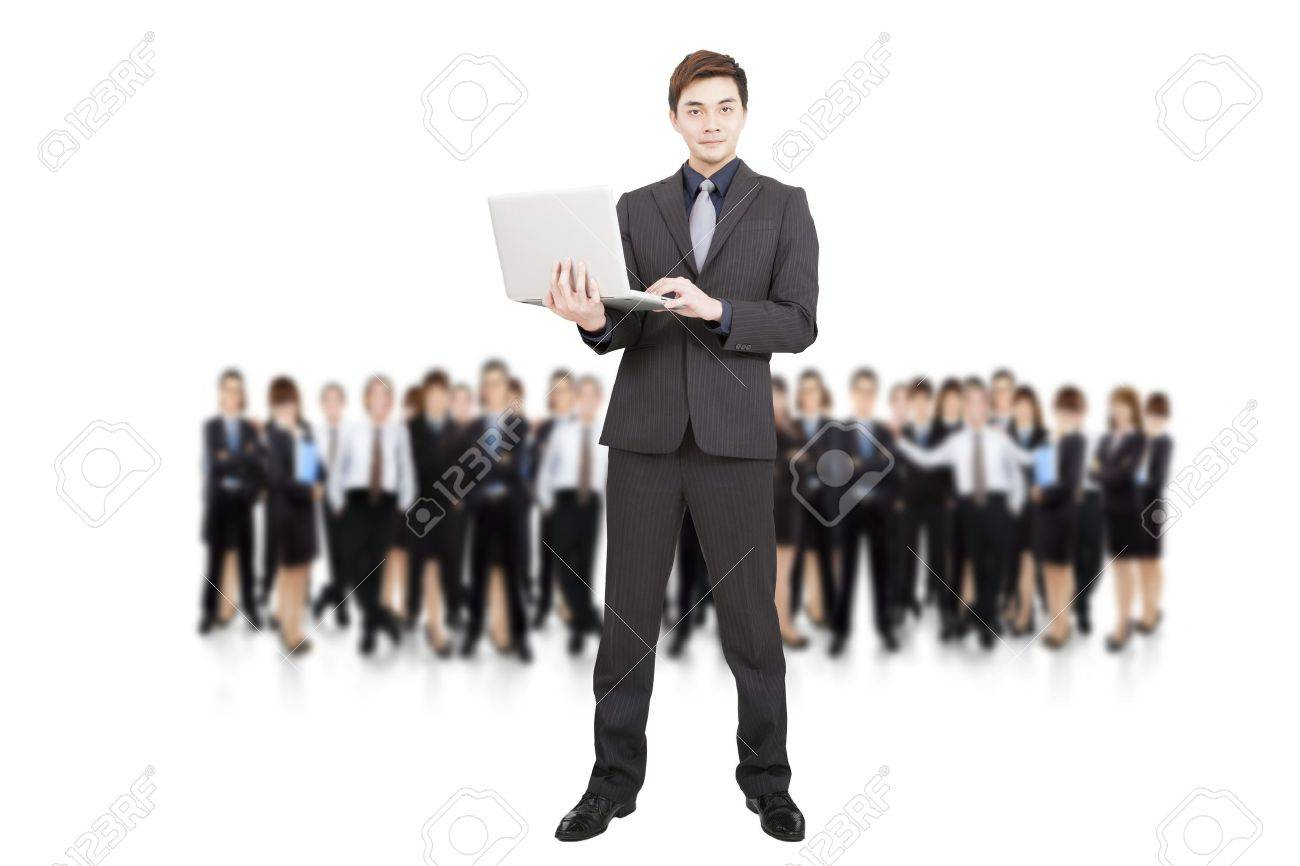 smart businessman holding laptop and successful business team Stock Photo - 17887825