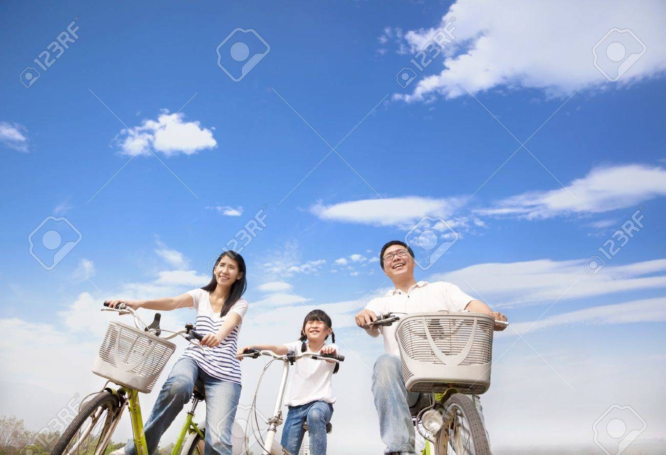 happy family riding bicycle with cloud background Stock Photo - 18878064
