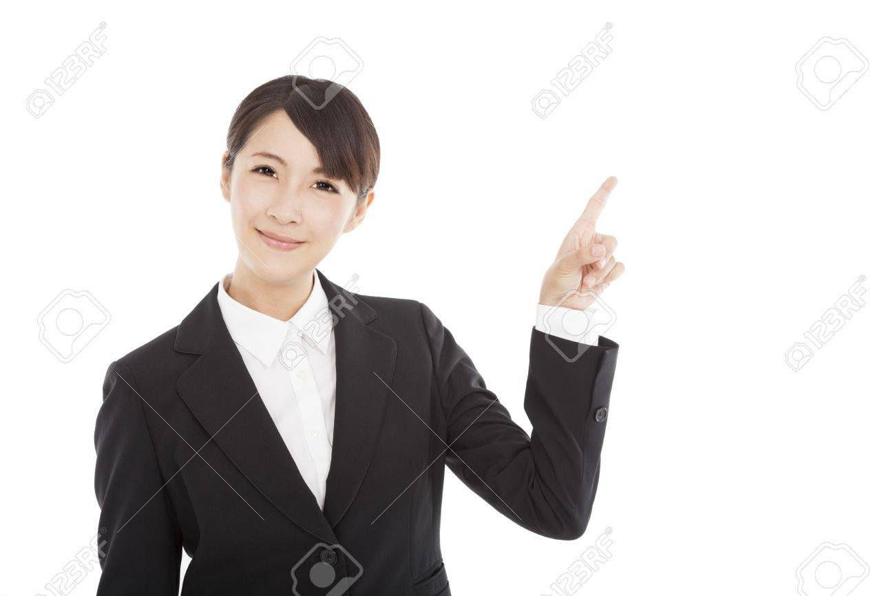 smiling business woman pointing to copy space Stock Photo - 20838289