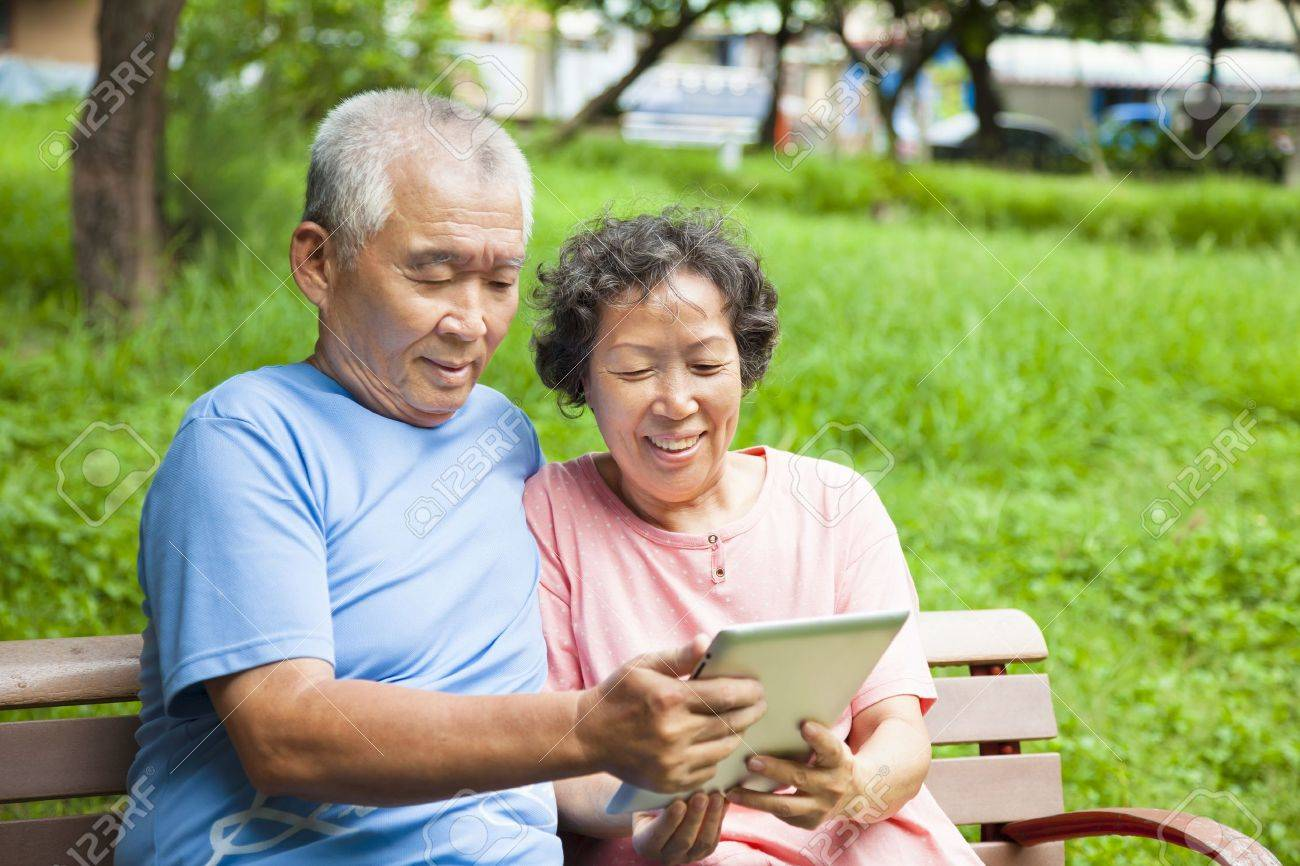 happy seniors couple with tablet pc in the park Stock Photo - 21492405