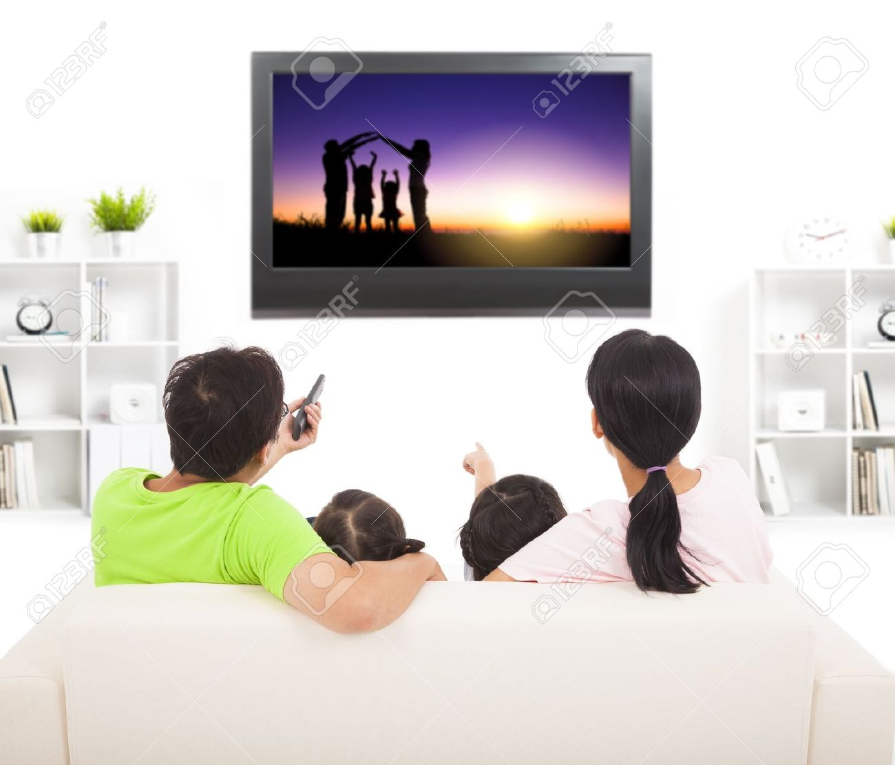 family watching the tv in living room Stock Photo - 21857073
