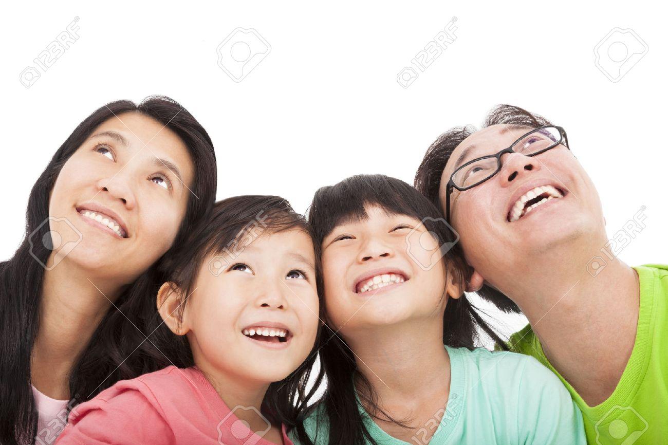 Happy family looking up Stock Photo - 22253429