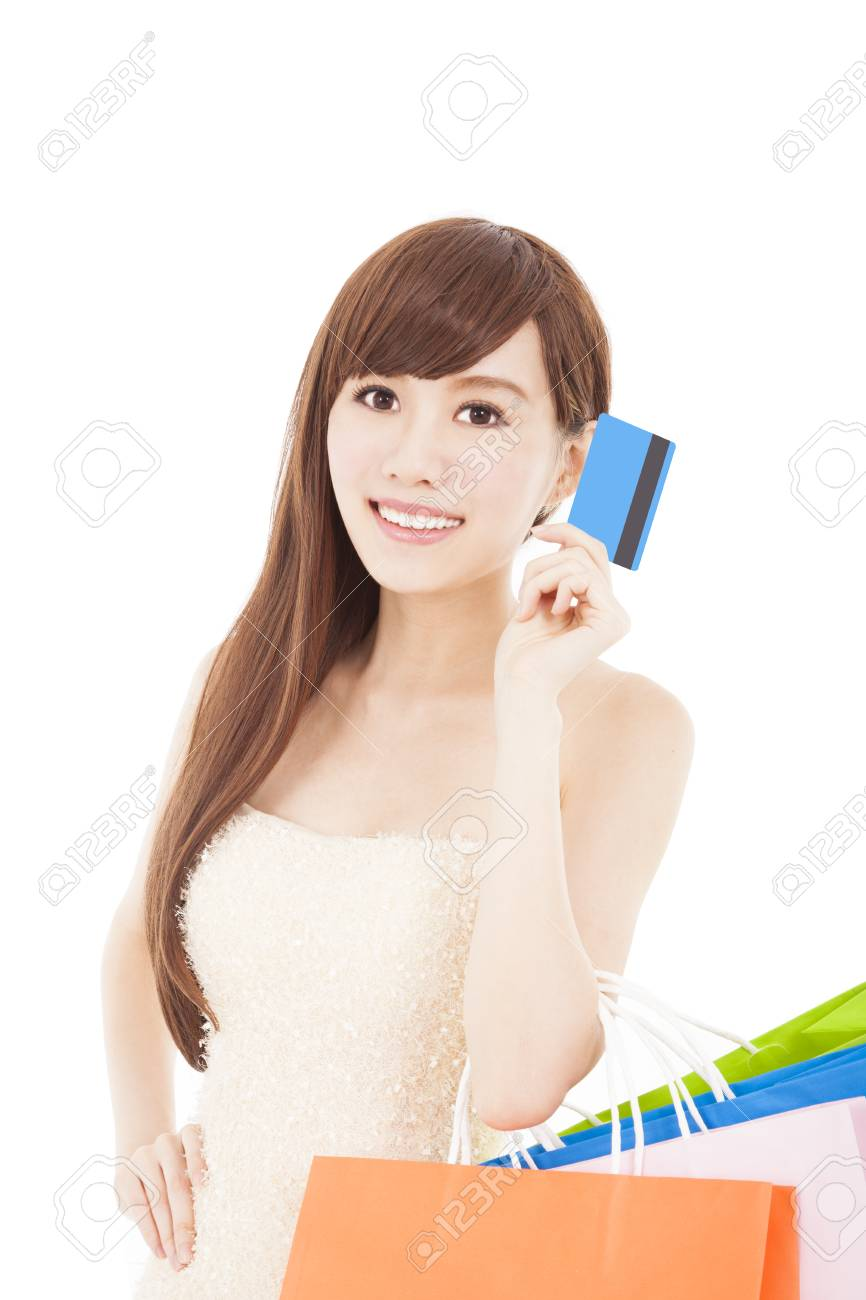 young woman with credit card and shopping bags Stock Photo - 23048131