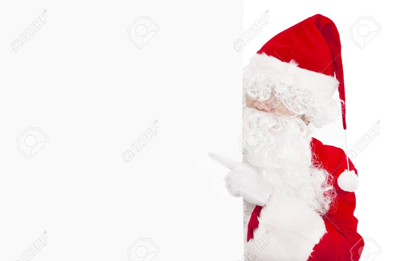 happy Santa Claus pointing at blank banner Stock Photo - 23731597
