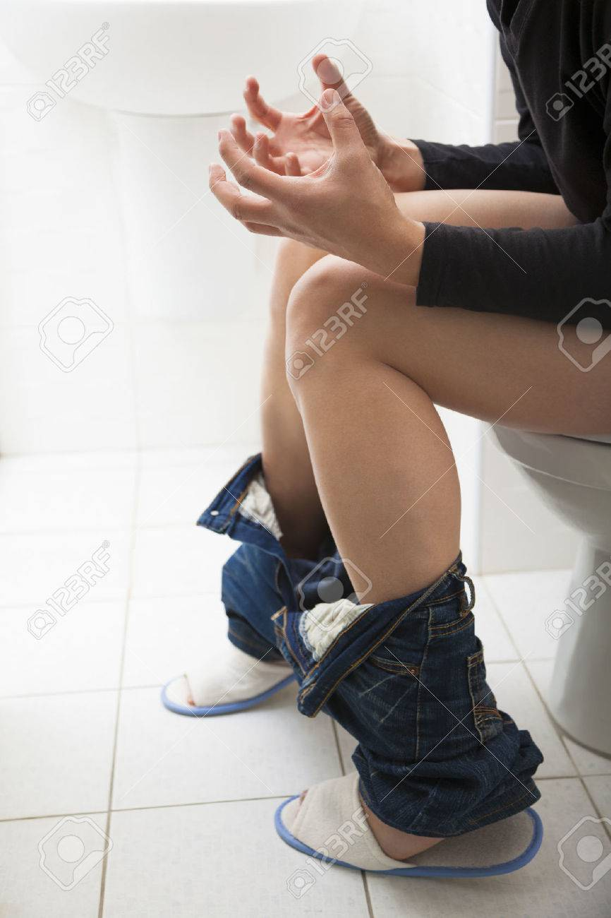 young man have constipation or diarrhea problems Stock Photo - 25056750