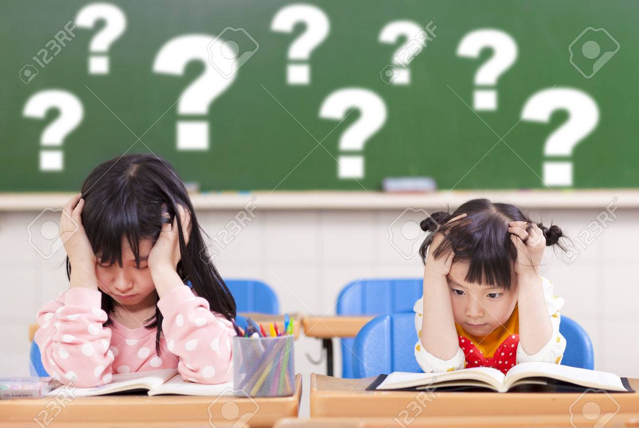 two kids is full of questions in class Stock Photo - 26902126