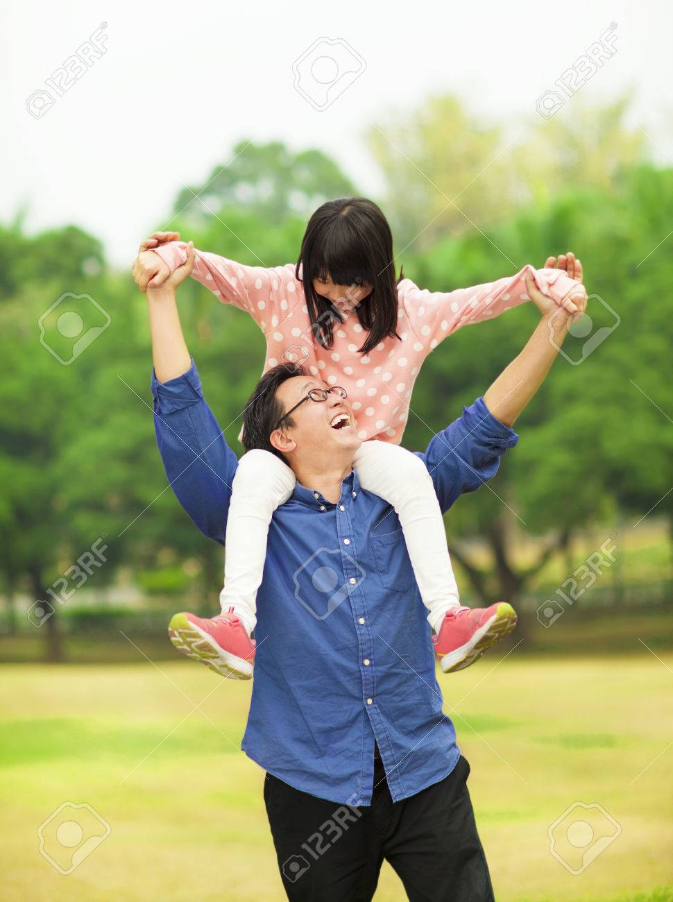 happy daughter sitting father's shoulder Stock Photo - 26963308