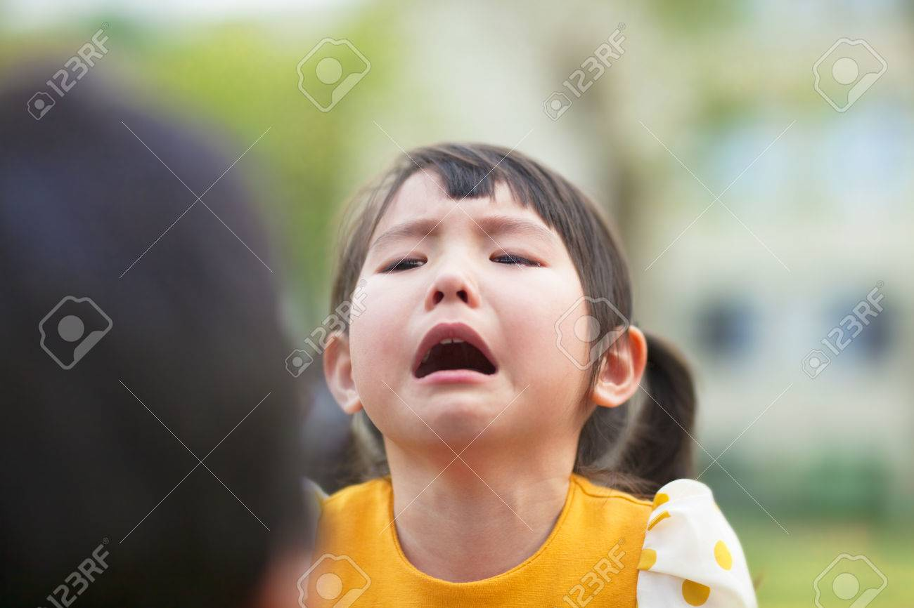 Asian girl cries mommy