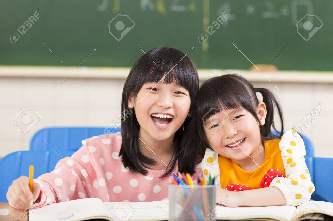 happy little girls in the classroom Stock Photo - 27065885