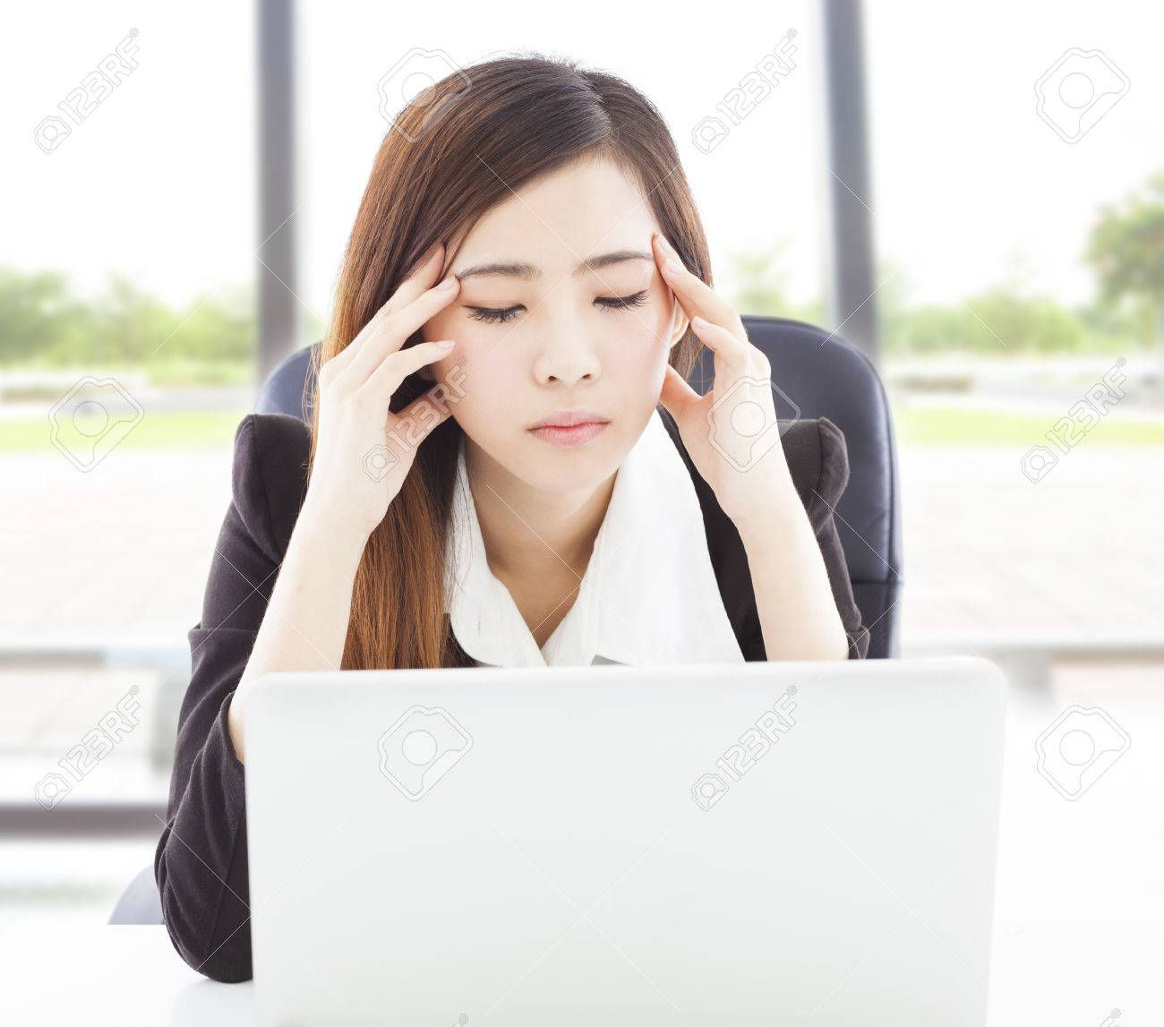 Young Business woman feel headach and full of painful expression Stock Photo - 28403981