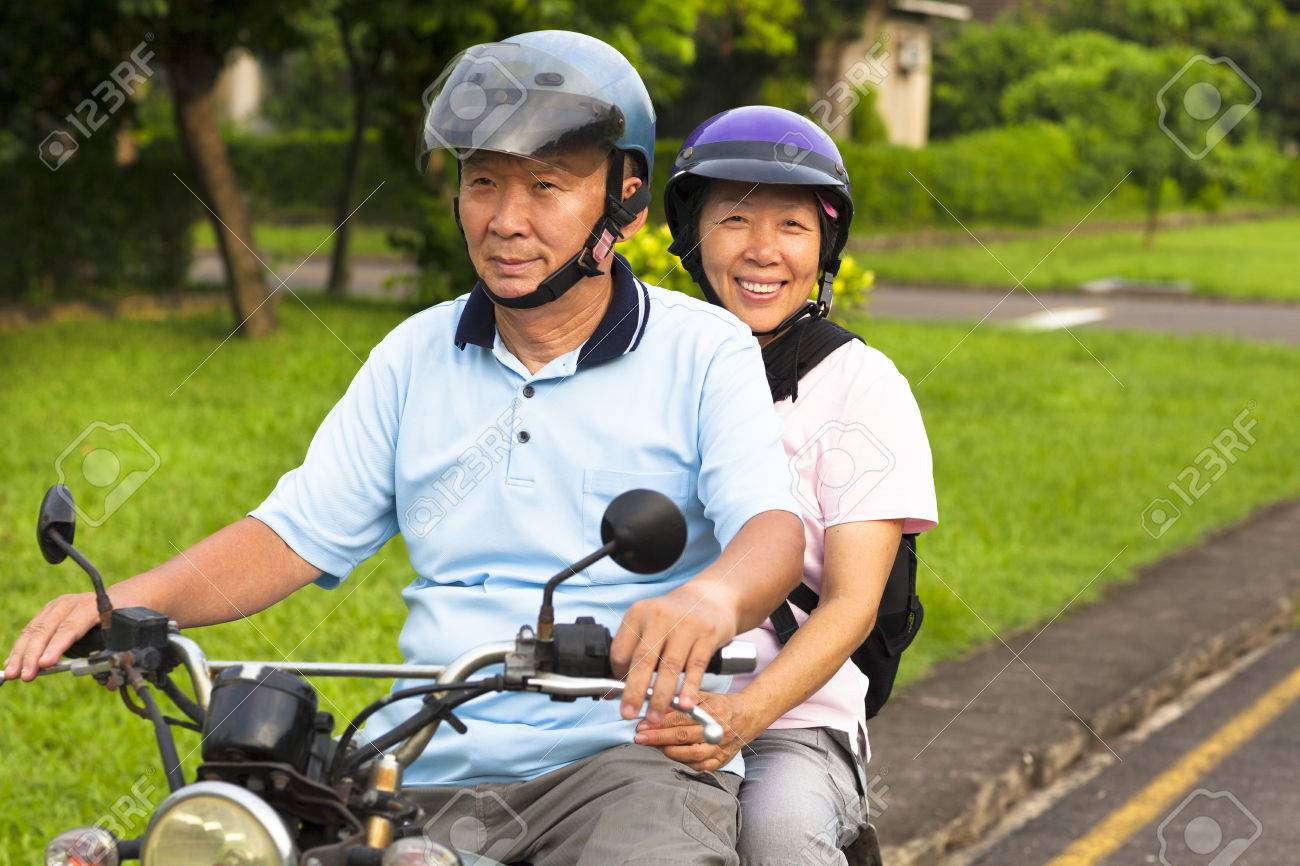 senior couple drive motorcycle to travel Stock Photo - 29618819