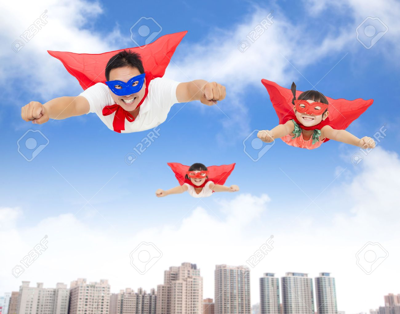 Superman and daughters flying in the sky with buildings background superman and daughters flying in the sky with buildings background stock photo 31567587 publicscrutiny Images