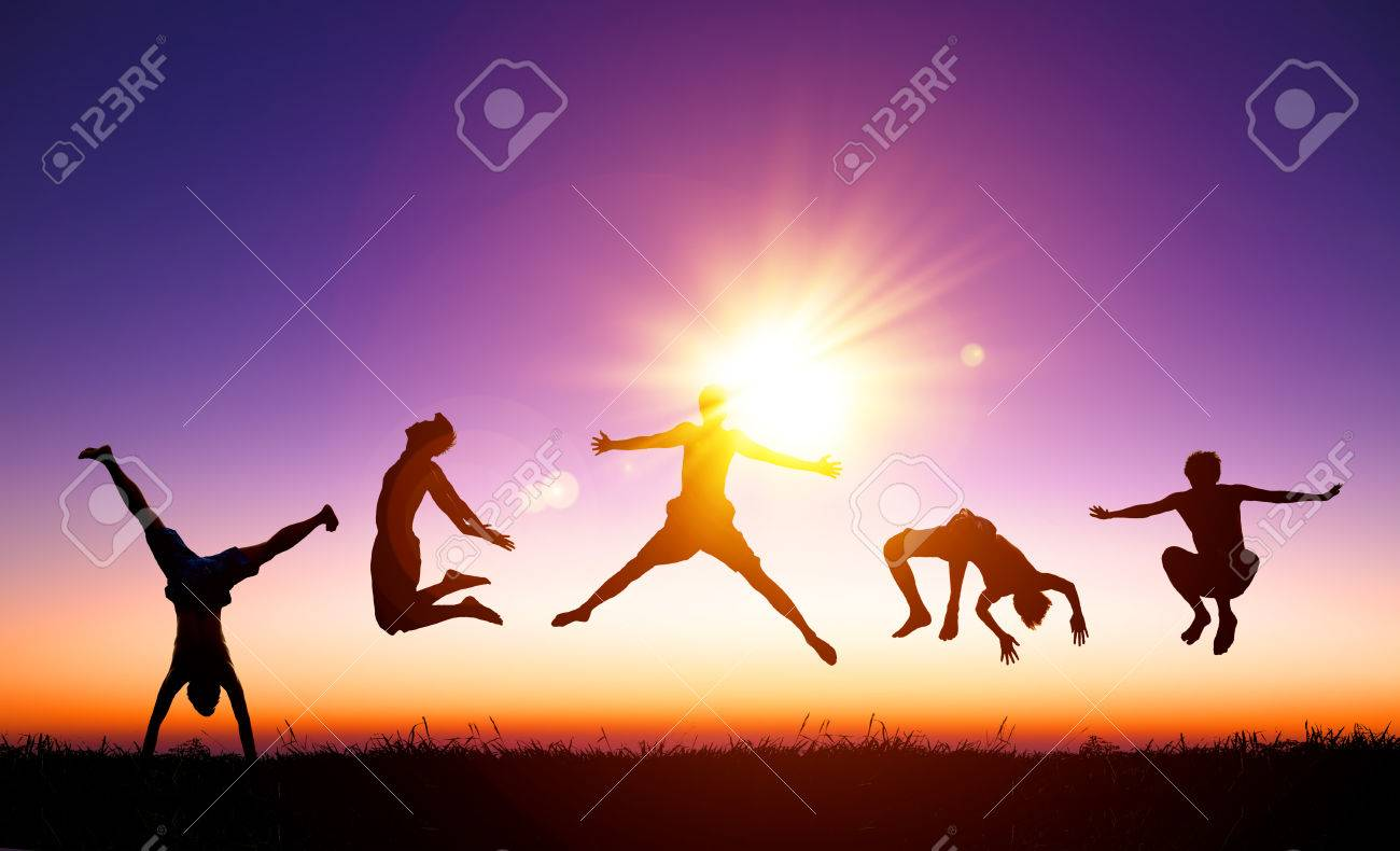 happy young people jumping on the hill with sunlight background - 34001848