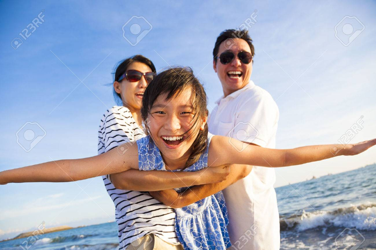 happy family enjoy summer vacation on the beach Stock Photo - 41024668