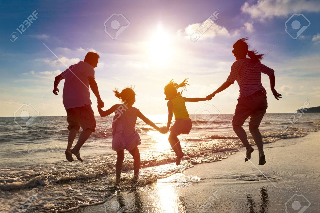 happy family jumping together on the beach Stock Photo - 41118428