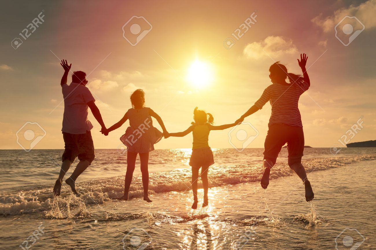 happy family jumping together on the beach Stock Photo - 41118459