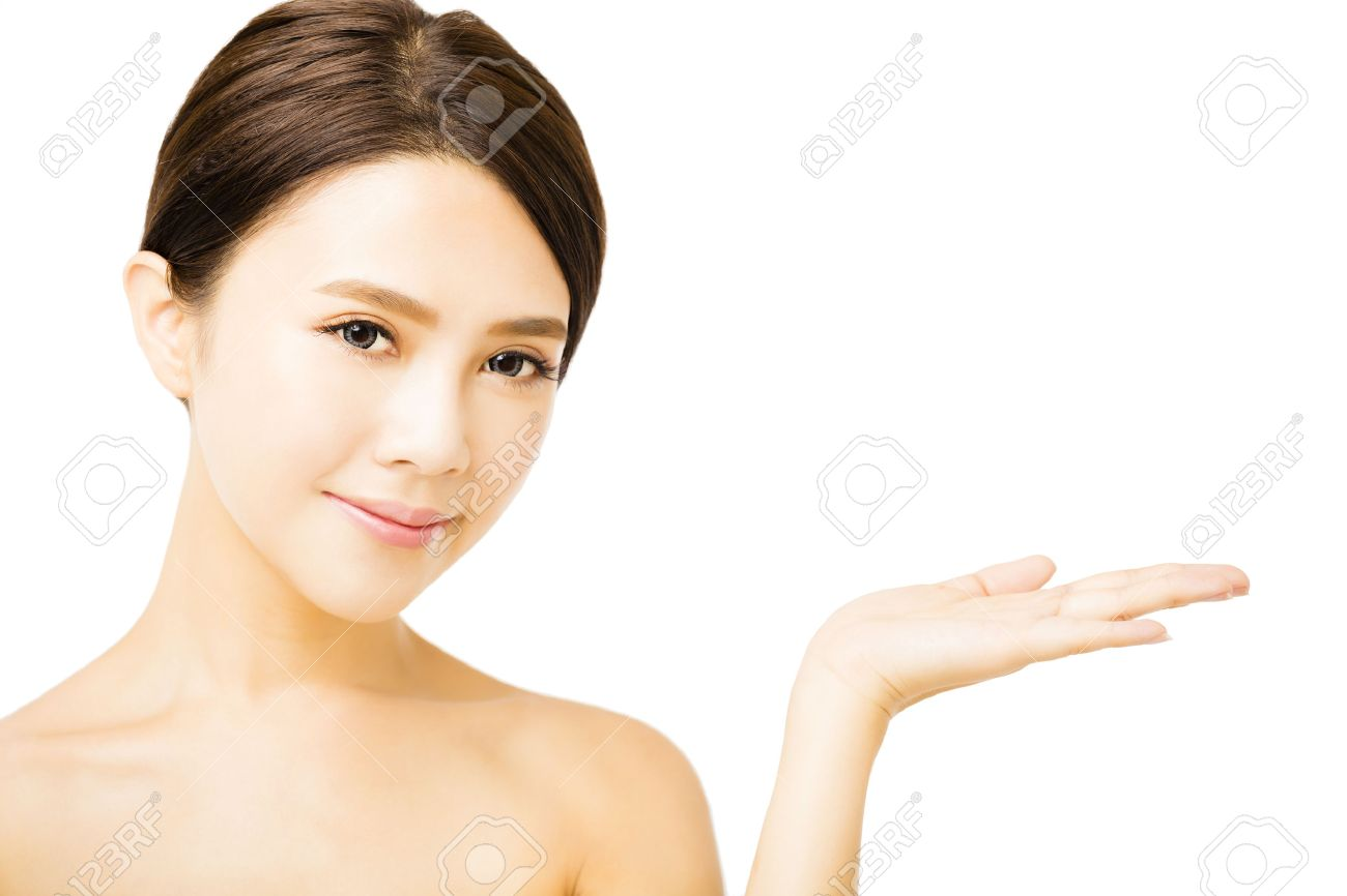beautiful young woman showing beauty product empty  space on  hand Stock Photo - 41966427