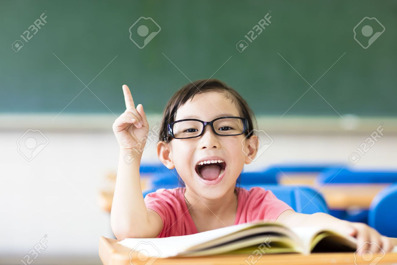 littl nude kids asian kid: happy little girl with idea gesture in the classroom