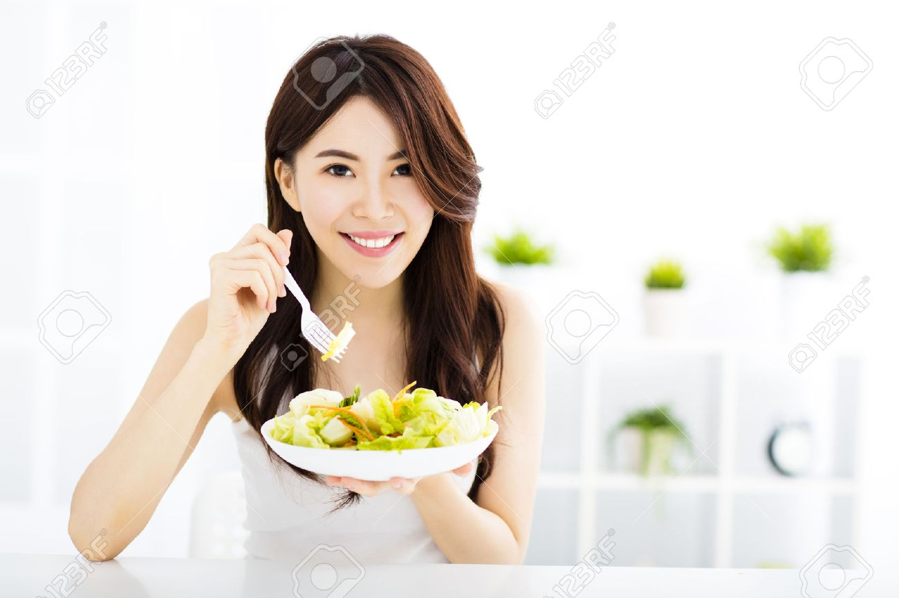 beautiful asian young woman eating healthy food Stock Photo - 44130693