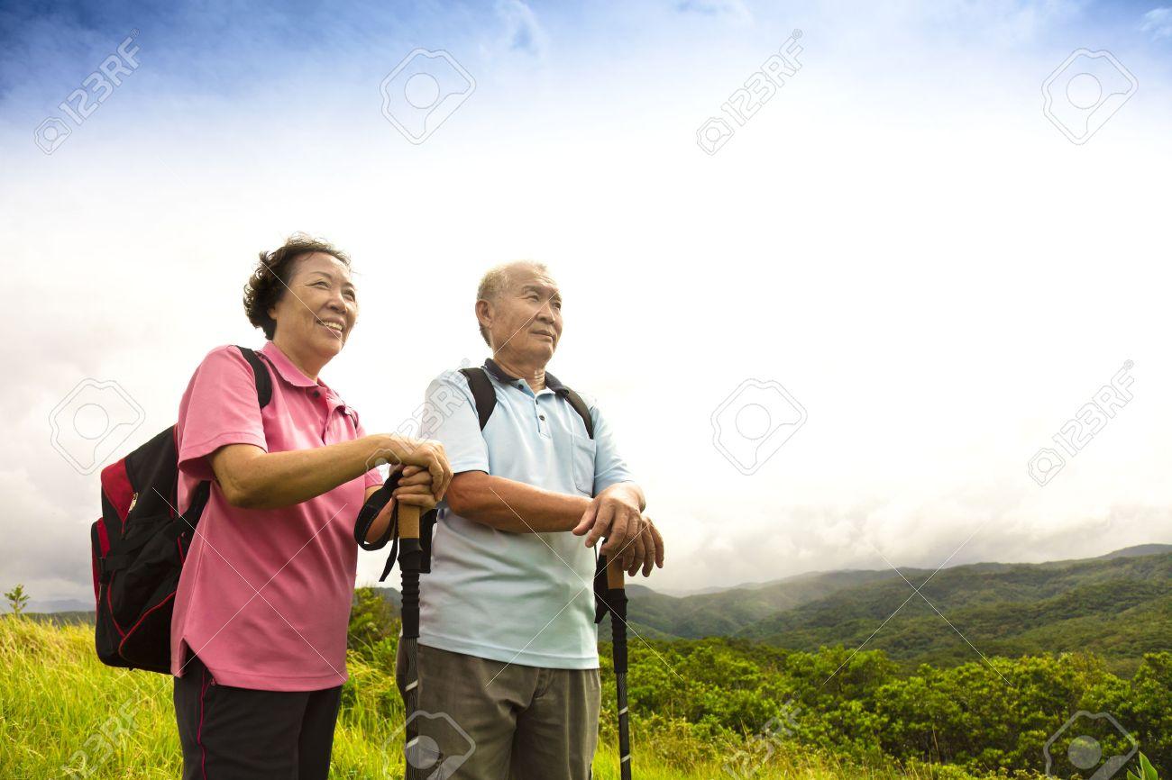 happy senior couple hiking on the mountain Stock Photo - 44685095
