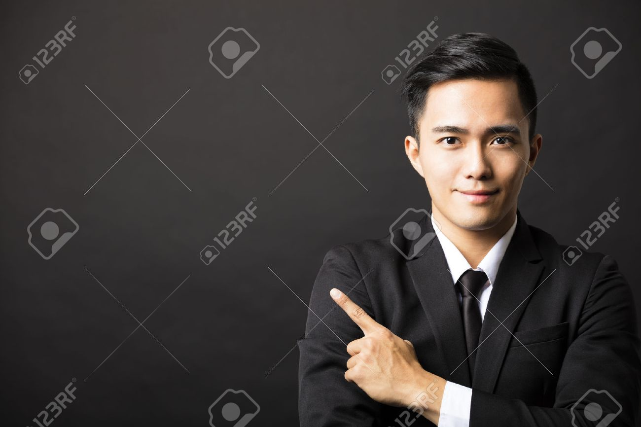 young  business man with pointing gesture Stock Photo - 45900926