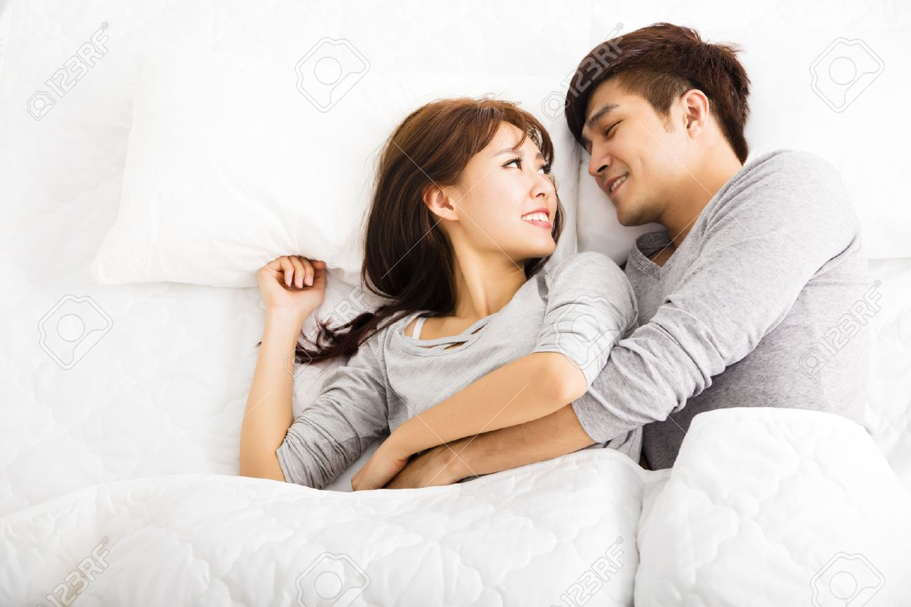 Lovely Couple In Bed Lying In Bedroom Lovers In Bed Images Stock Pictures Royalty Free Lovers In Bed