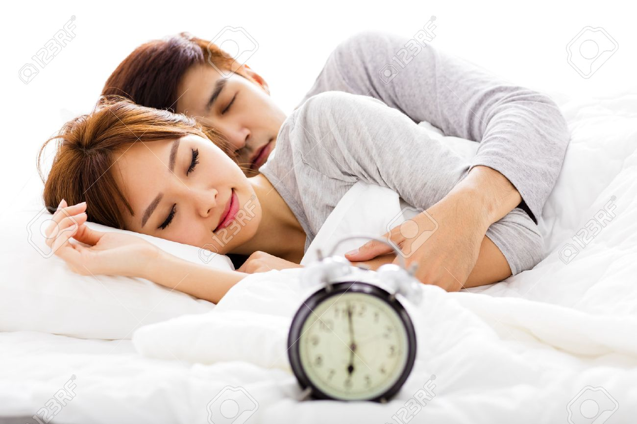 Young couple sleeping in bed next to an alarm clock. Lovers In Bed Images   Stock Pictures  Royalty Free Lovers In Bed