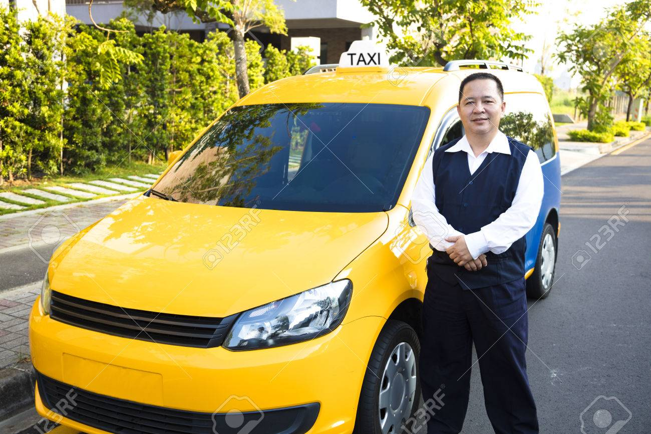 Portrait Of Smiling Taxi Driver With Car Stock Photo   49363958
