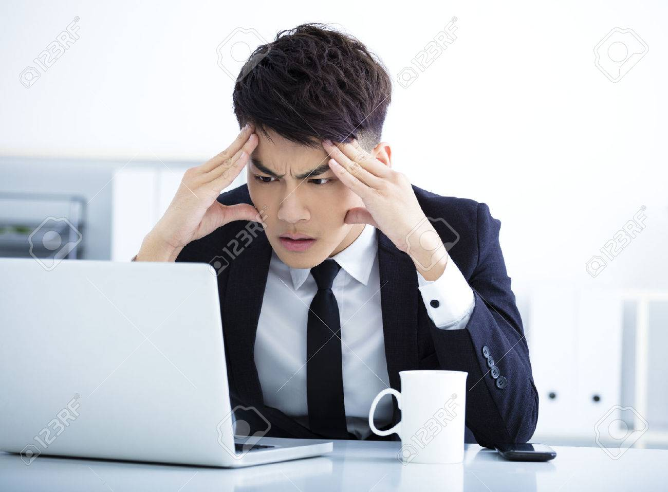 Businessman having stress in the office - 52000876
