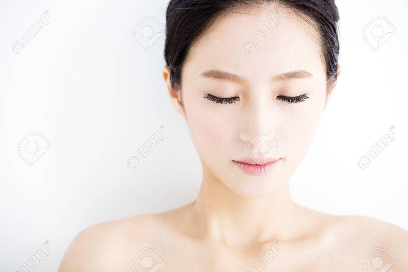 closeup beautiful young woman face - 52904235