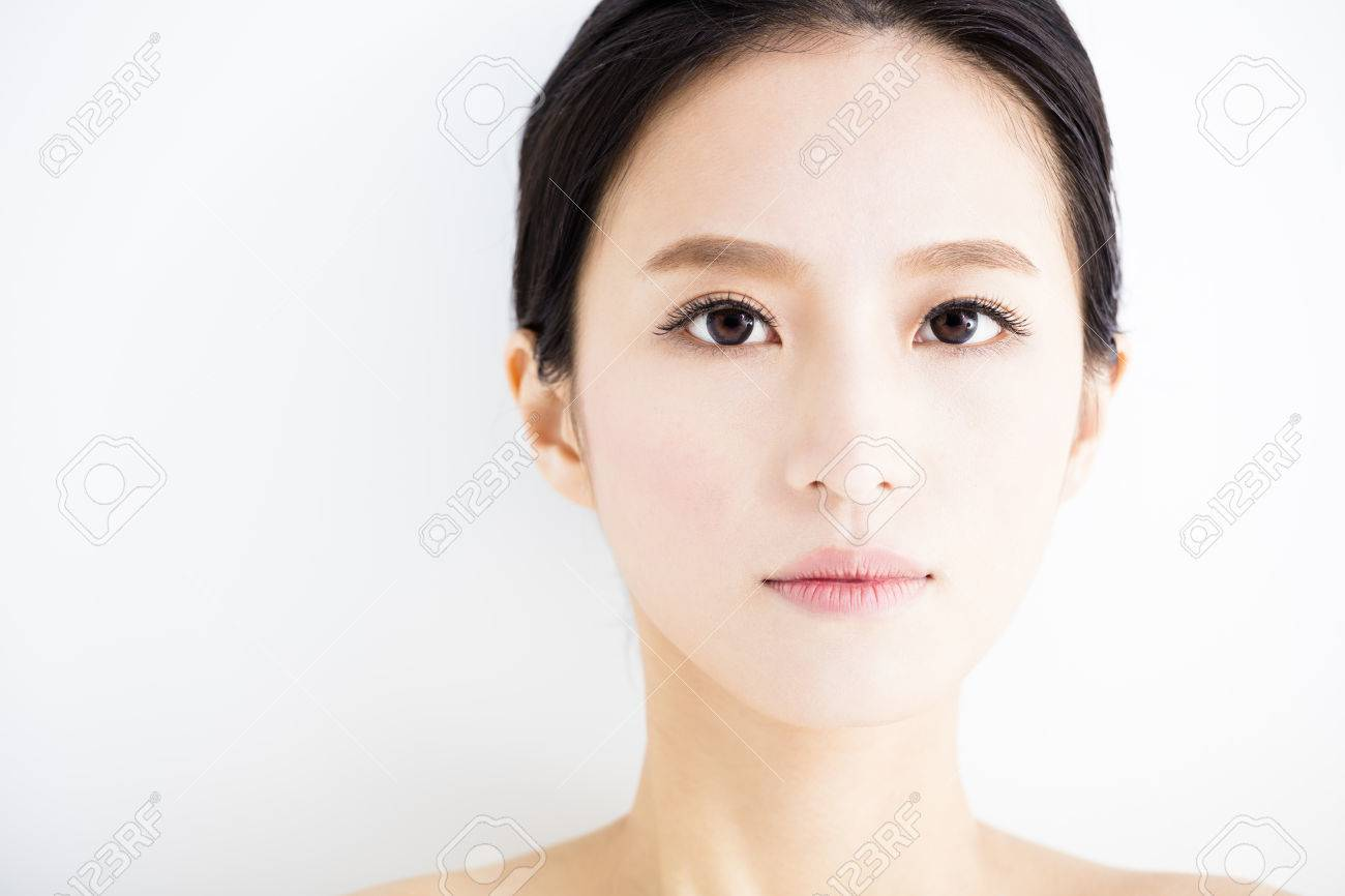 closeup beautiful young woman face - 52904241