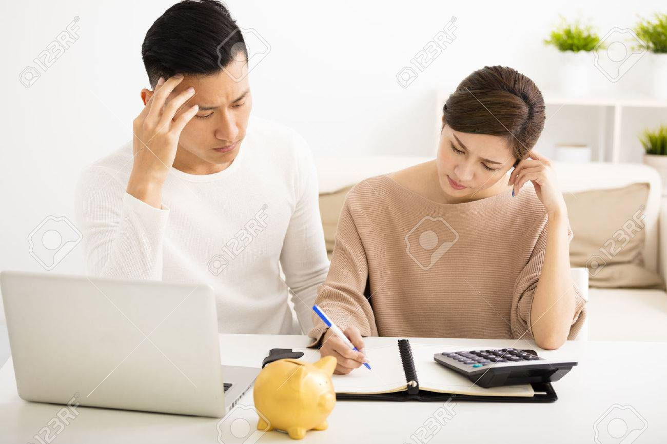 husband and wife with financial stress - 53697007