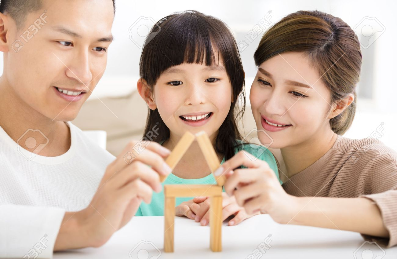 happy family playing with toy blocks Stock Photo - 54004067
