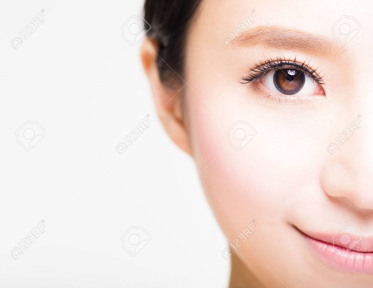 half face of young beautiful woman - 54004084