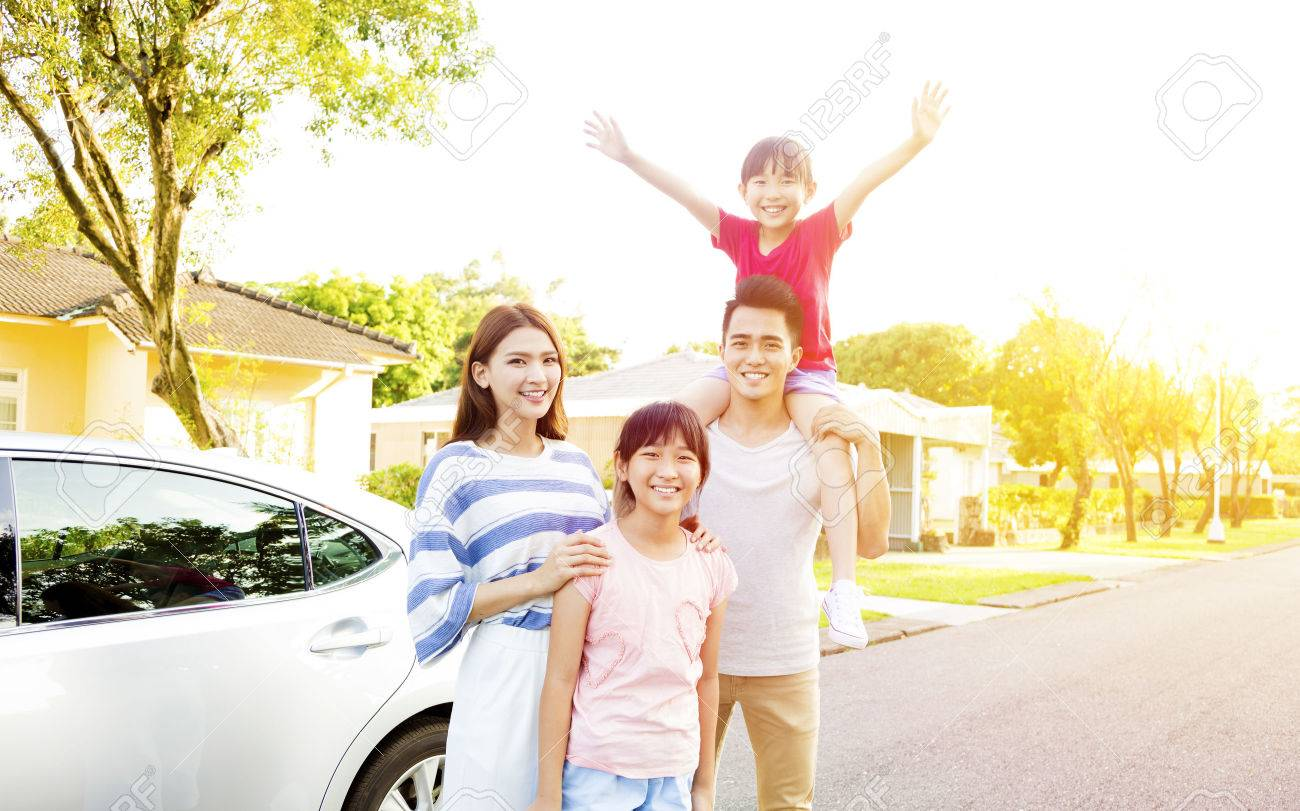 Beautiful happy family portrait  outside their  house Stock Photo - 56086040