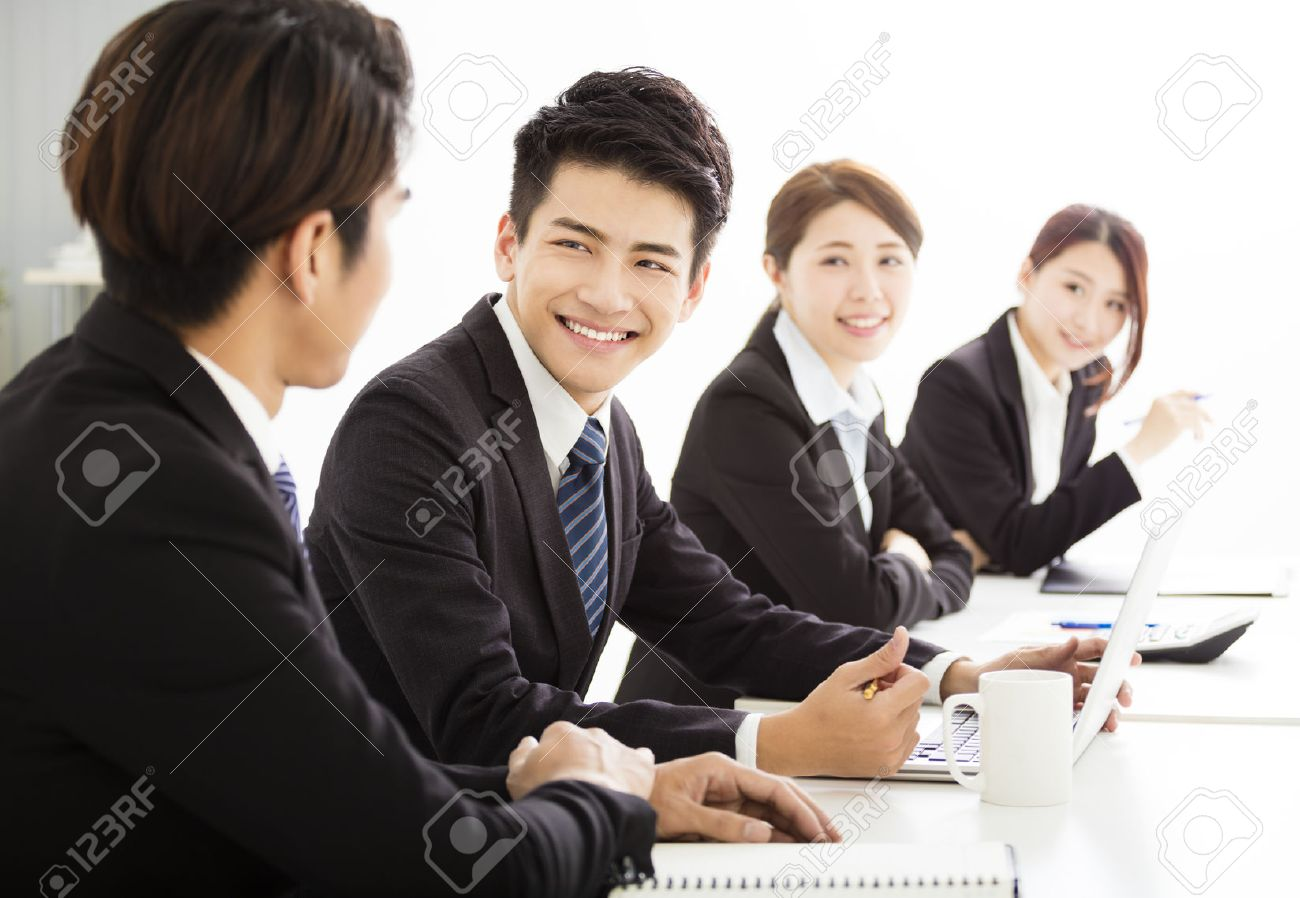 group of business people having meeting together - 56373252