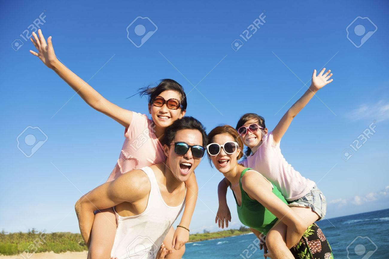 Happy Family Having Fun at the Beach - 57765077