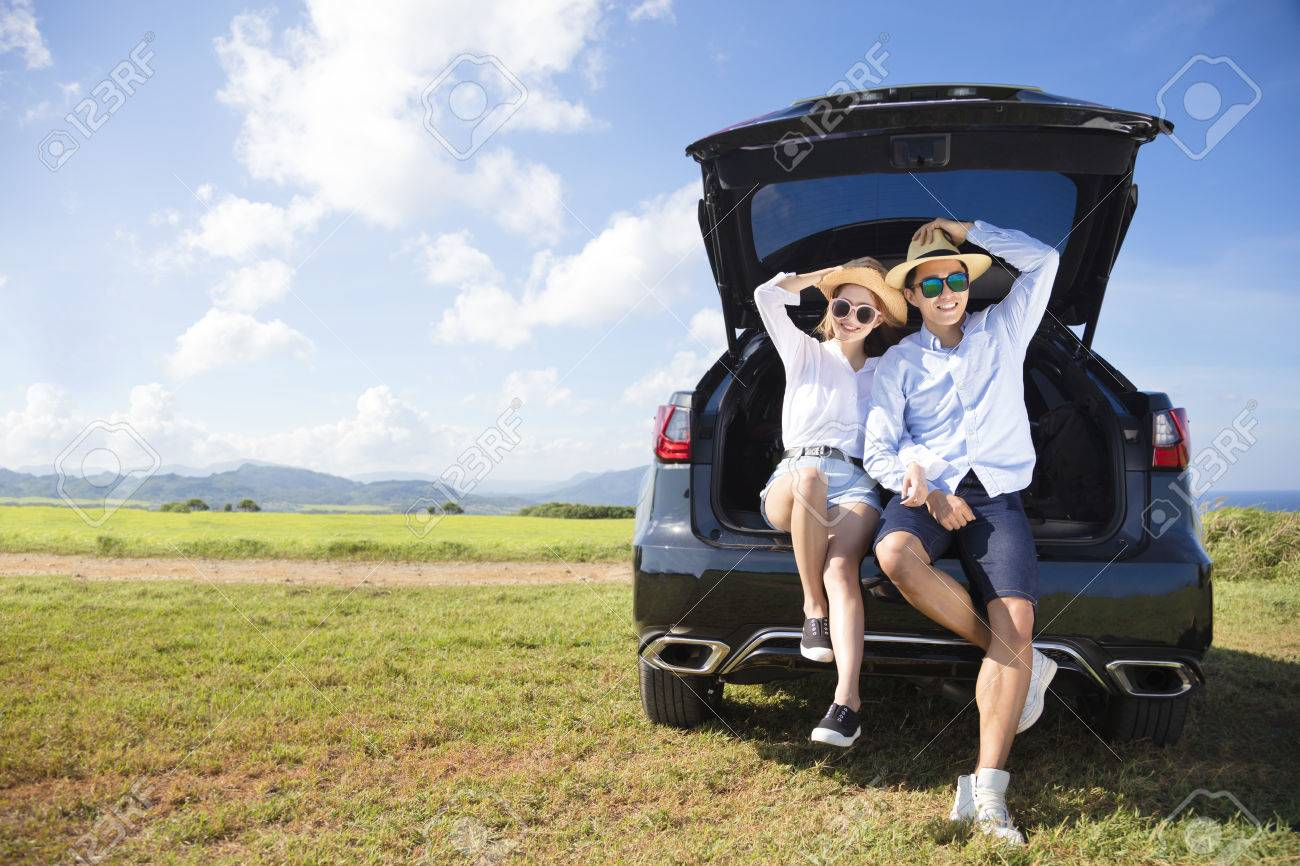 young couple enjoying road trip and summer vacation - 57978665