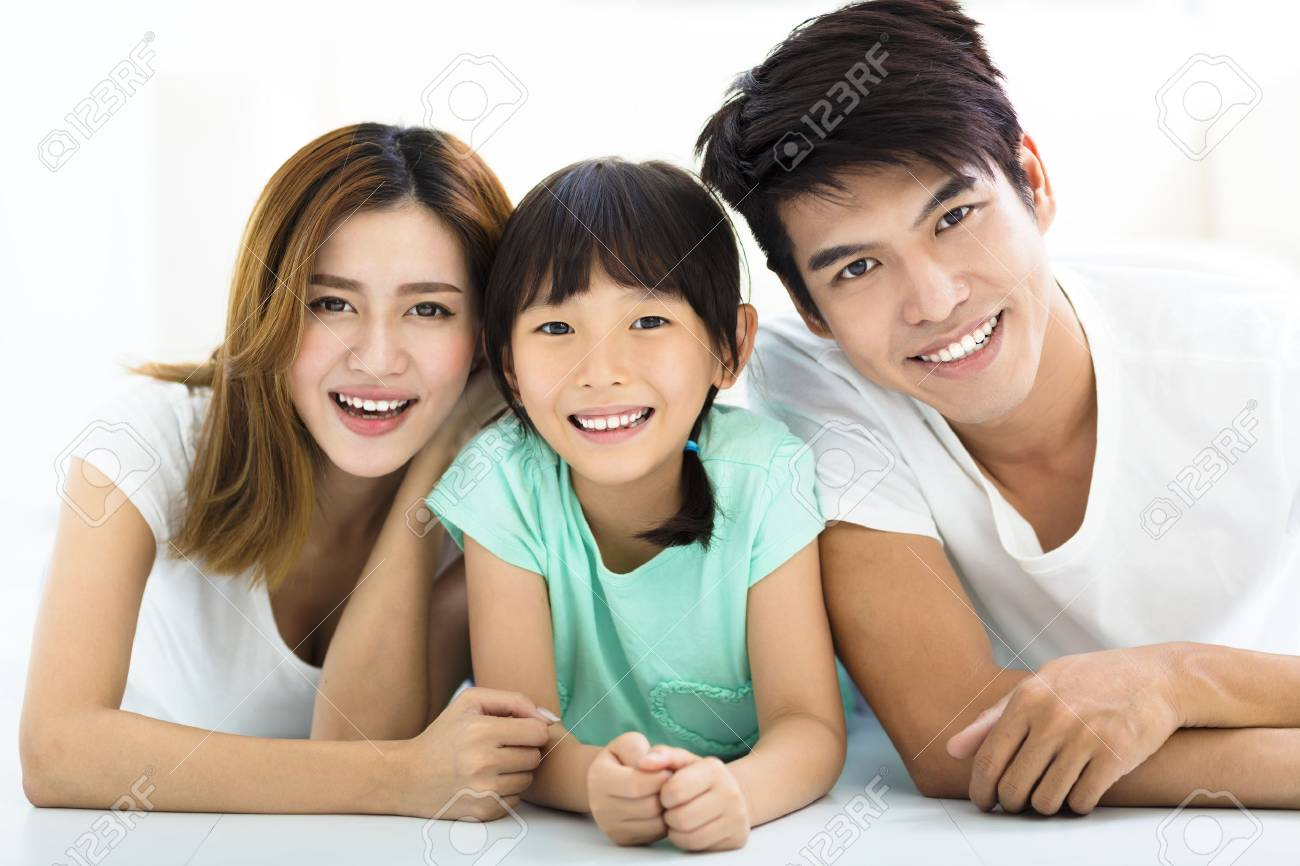 Happy Attractive Young Family and little girl - 60366025
